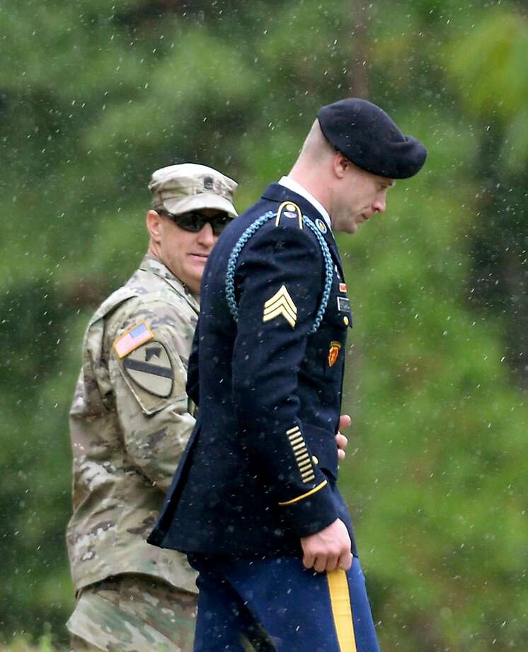 "FORT BRAGG, NC - OCTOBER 16:  U.S. Army Sgt. Robert Bowdrie ""Bowe"" Bergdahl (R), 29 of Hailey, Idaho, is escorted out of the Ft. Bragg military courthouse on October 16, 2017 in Fort Bragg, North Carolina. Bergdahl pled guilty to desertion and misbehavior before the enemy. He could face life in prison stemming from his decision to leave his outpost in 2009, which landed him five years in Taliban captivity. (Photo by Sara D. Davis/Getty Images) Photo: Sara D. Davis, Getty Images"
