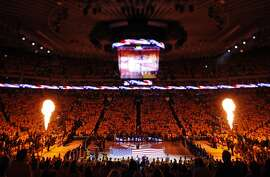 Warriors fans watch as a pyrotechnic show erupts during the National Anthem before the game. The Golden State Warriors played the New Orleans Pelicans in Game 2 of the 1st Round of NBA Western Conference Playoffs at Oracle Arena in Oakland, Calif., on Monday, April 20, 2015.