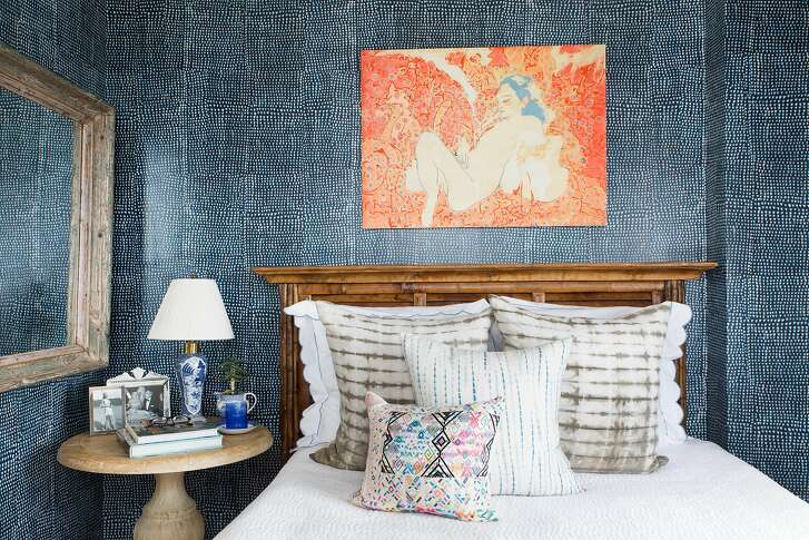 Christina Bryant's bedroom walls are wrapped in indigo paper with a West African textile pattern.