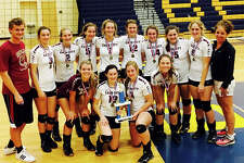 Members of the Cass City volleyball team pose with the championship trophy after winning the Mt. Morris Tournament Saturday, at Burton Bendle High School. (Courtesy Photo)