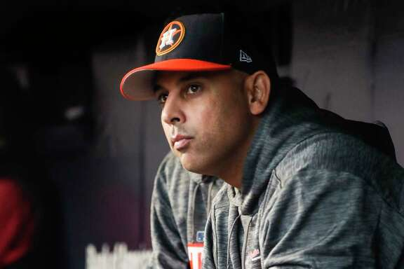 Houston Astros bench coach Alex Cora sits in the dugout before Game 3 of the ALCS against the New York Yankees at Yankee Stadium on Monday, Oct. 16, 2017, in New York.