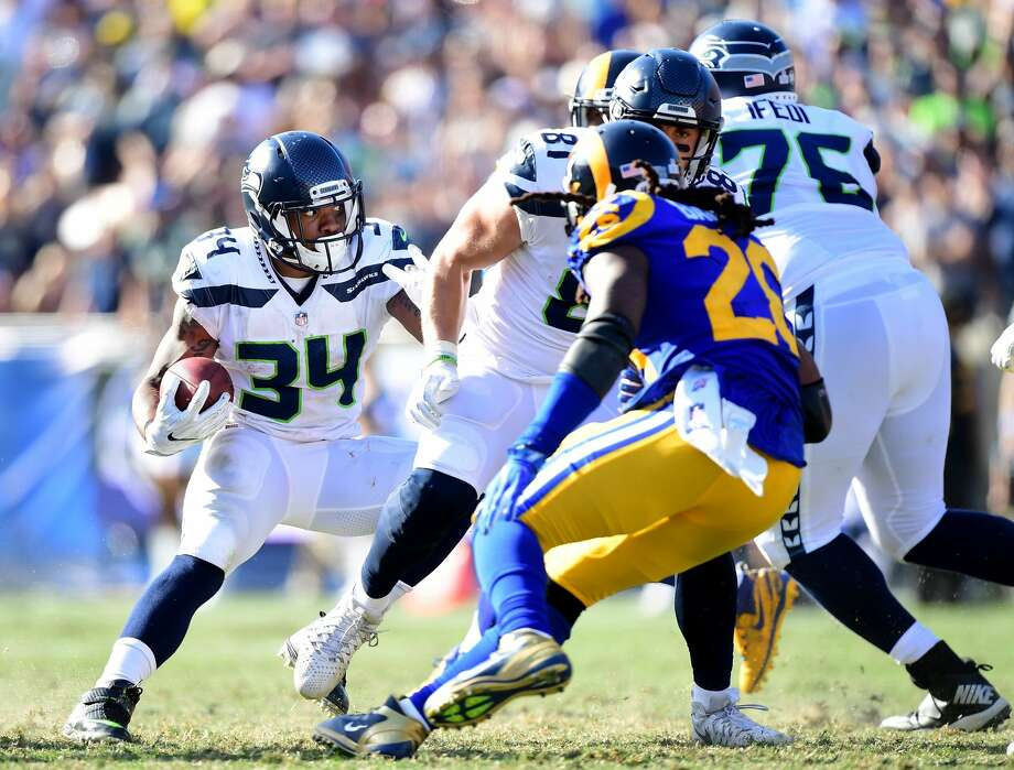 LOS ANGELES, CA - OCTOBER 08:  Thomas Rawls #34 of the Seattle Seahawks cuts backk on  Mark Barron #26 of the Los Angeles Rams during the fourth quarter in at 16-10 Seahawks win at Los Angeles Memorial Coliseum on October 8, 2017 in Los Angeles, California.  (Photo by Harry How/Getty Images) Photo: Harry How/Getty Images