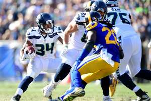 LOS ANGELES, CA - OCTOBER 08:  Thomas Rawls #34 of the Seattle Seahawks cuts backk on  Mark Barron #26 of the Los Angeles Rams during the fourth quarter in at 16-10 Seahawks win at Los Angeles Memorial Coliseum on October 8, 2017 in Los Angeles, California.  (Photo by Harry How/Getty Images)