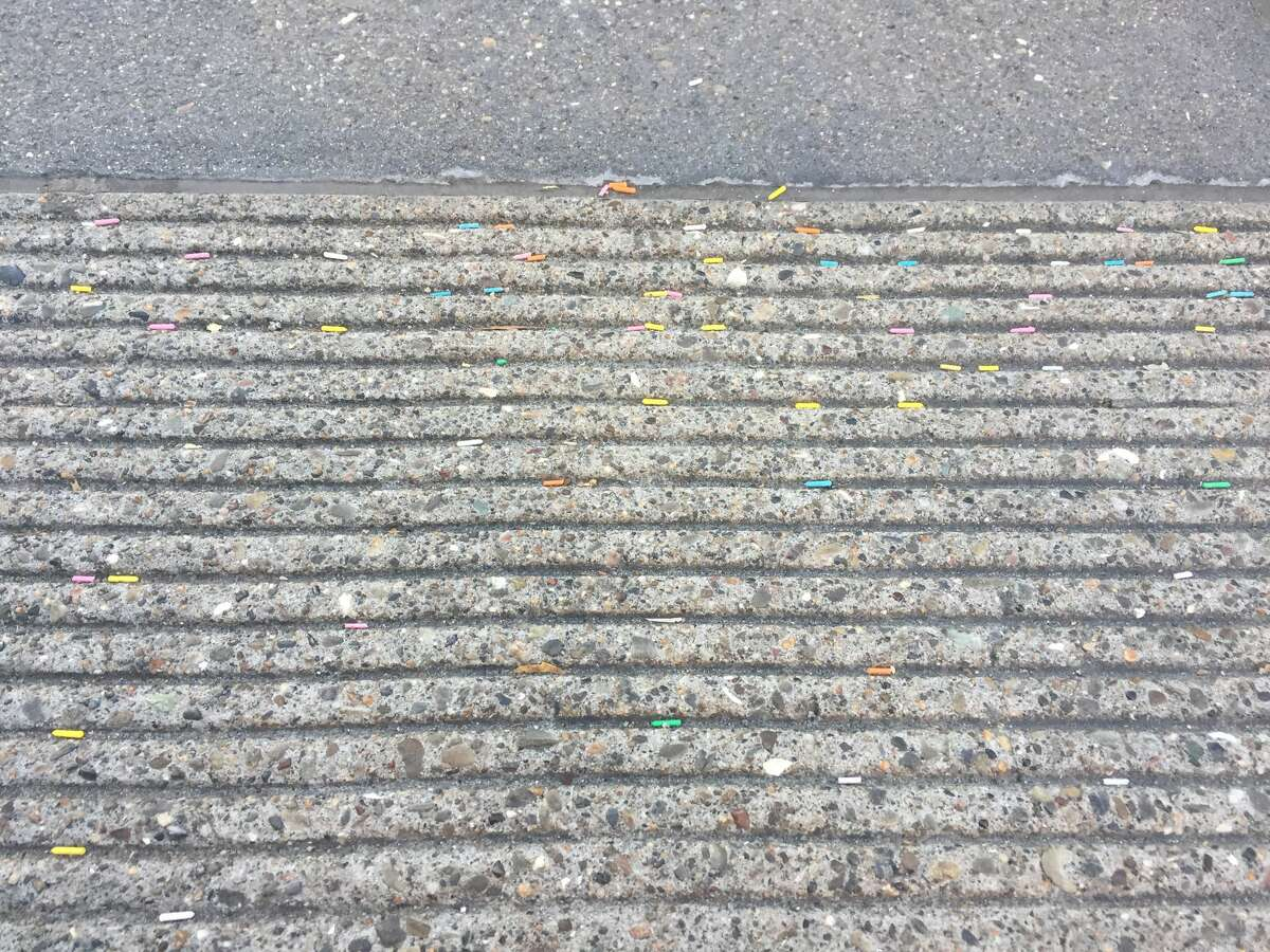 Plastic sprinkles can be seen on the sidewalks around the Museum of Ice Cream's San Francisco location. Environmentalists worry about the impact of the plastic washing into storm drains.