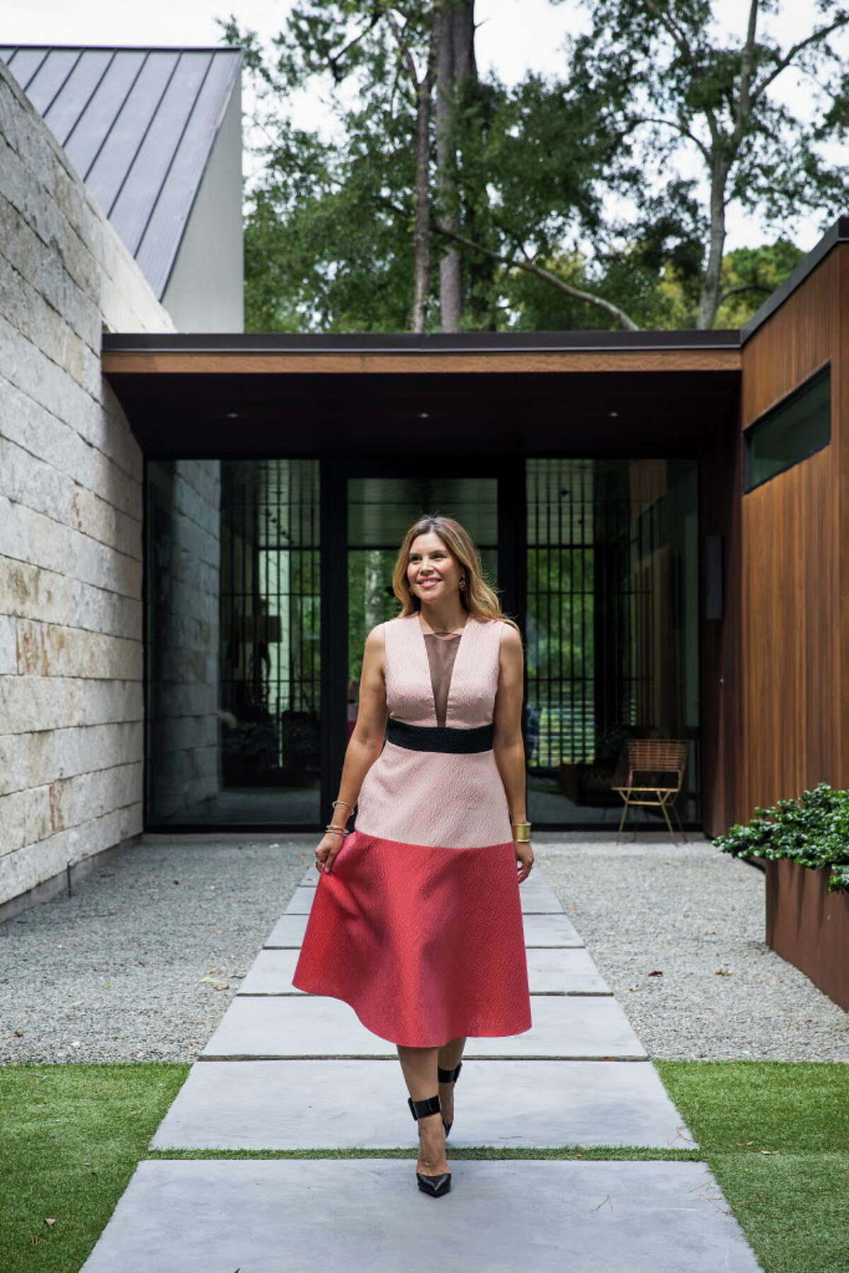 """Estela Cockrell, a former attorney who recently launched """"Switch 2 Pure,"""" an all-natural beauty subscription service stands outside her Houston home Tuesday, Sept. 19, 2017. ( Michael Ciaglo / Houston Chronicle)"""