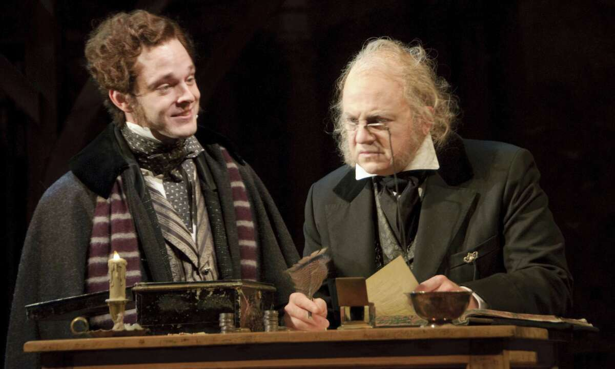"""(L-R) Jay Sullivan as Fred and Jeffrey Bean as Ebenezer Scrooge in the Alley Theatre's """"A Christmas Carol - A Ghost Story of Christmas."""" A Christmas Carol runs on the Alley's Hubbard Stage November 16 - December 24, 2012. Photo by Mike McCormick."""