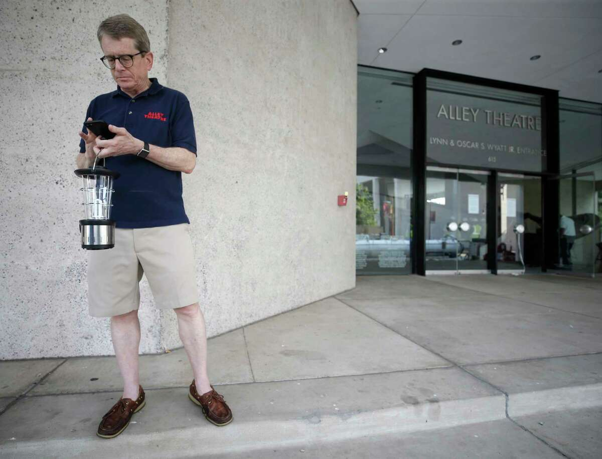 Dean Gladden, managing director of the Alley Theatre makes phone calls Sept. 1, after the hurricane struck.
