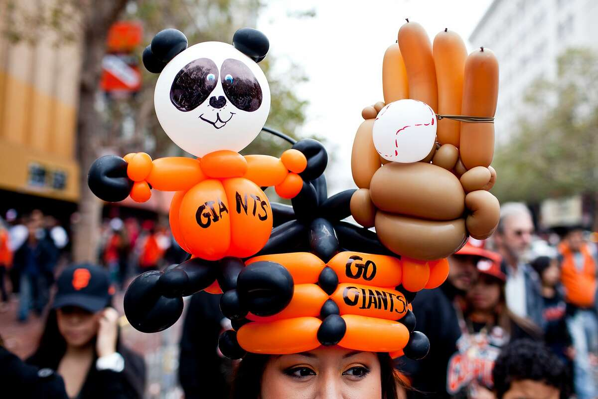 Sandra Navarro, of Vallejo, wore a panda and glove balloon hat for the Giants World Series Championship parade in San Francisco, Calif., Wednesday, October 31, 2012.