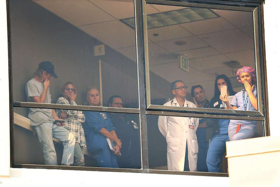 A crowd on the 2nd floor of Santa Rosa Memorial Hospital watch during a media briefing on Monday, October 16, 2017, about the hospital's response to the Wine Country Fires in Santa Rosa. Photo: Scott Strazzante, The Chronicle