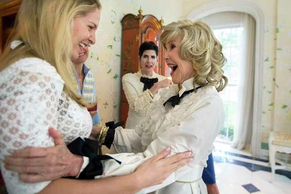 Kelli Krohn embraces Joanne King Herring during her birthday party on Tuesday, Sept. 26, 2017, in River Oaks. (Annie Mulligan / Freelance)