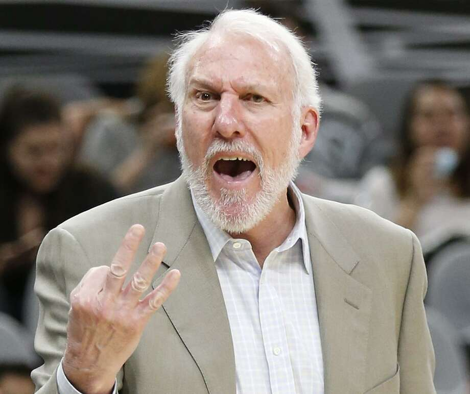Spurs head coach Gregg Popovich has words for game official Lauren Holtkamp (left) as the Spurs take on the Orlando Magic during their pre-season game at the AT&T Center on Tuesday, Oct. 10, 2017. Magic defeated the Spurs, 103-98. (Kin Man Hui/San Antonio Express-News) Photo: Kin Man Hui, Staff / San Antonio Express-News / ©2017 San Antonio Express-News
