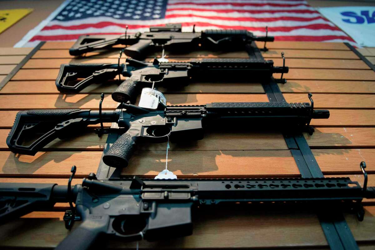 Assault rifles hang on the wall for sale at Blue Ridge Arsenal in Chantilly, Virginia, on October 6, 2017. / AFP PHOTO / JIM WATSONJIM WATSON/AFP/Getty Images