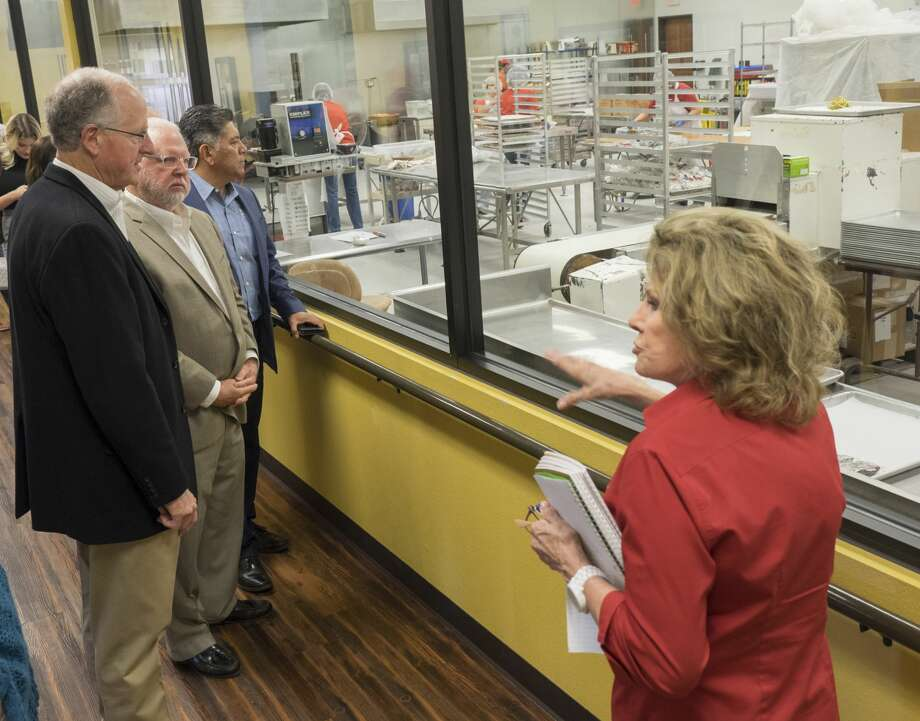 Susie Hitchcock-Hall, owner and President of Susie's South Forty Confections, gives a tour to U.S. Rep Mike Conaway and other area business leaders 10/16/17 before a roundtable discussion with area business leaders. Tim Fischer/Reporter-Telegram Photo: Tim Fischer/Midland Reporter-Telegram