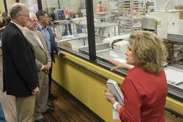 Susie Hitchcock-Hall, owner and President of Susie's South Forty Confections, gives a tour to U.S. Rep Mike Conaway and other area business leaders 10/16/17 before a roundtable discussion with area business leaders. Tim Fischer/Reporter-Telegram