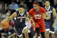 Connecticut's Jalen Adams (2) dribbles up the floor as SMU's Ben Moore (00) defends at Moody Coliseum in Dallas on Thursday, March 3, 2016. SMU won, 80-54. (Brad Horrigan/Hartford Courant/TNS)