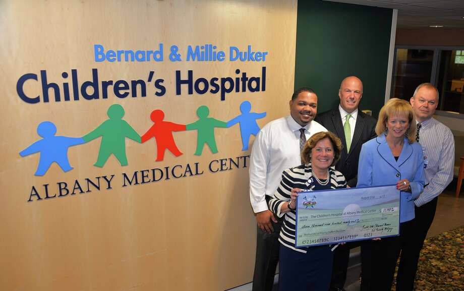The Bernard & Millie Duker Children?s Hospital at Albany Medical Center was presented with a check for $11,790 from Howard Hanna Real Estate Services during a ceremony earlier this week at  the hospital. (photo provided)