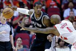 File-This Oct. 13, 2017, file photo shows San Antonio Spurs forward LaMarcus Aldridge (12) looking to drive around Houston Rockets forward PJ Tucker (4) in the first half of an NBA preseason basketball game in Houston. The Spurs have reached agreement with Aldridge on an extension that will keep him under contract for an additional three years.(AP Photo/Michael Wyke, File)