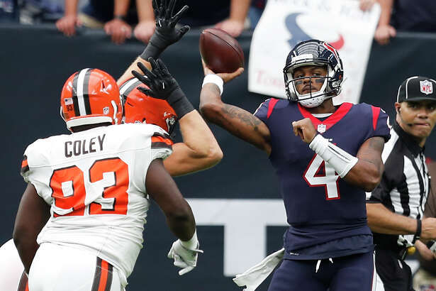 Houston Texans quarterback Deshaun Watson (4) throws a pass over Cleveland Browns defensive tackle Trevon Coley (93) during the second quarter of an NFL football game at NRG Stadium on Sunday, Oct. 15, 2017, in Houston. ( Brett Coomer / Houston Chronicle )