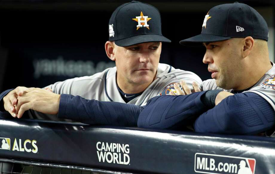 Houston Astros manager A.J. Hinch, left, and designated hitter Carlos Beltran (15) talk before Game 3 of the ALCS against the New York Yankees at Yankee Stadium on Monday, Oct. 16, 2017, in New York. Photo: Karen Warren, Houston Chronicle / © 2017 Houston Chronicle