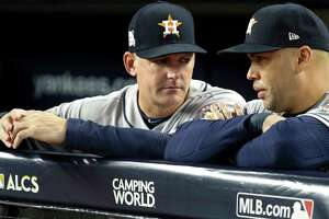 Houston Astros manager A.J. Hinch, left, and designated hitter Carlos Beltran (15) talk before Game 3 of the ALCS against the New York Yankees at Yankee Stadium on Monday, Oct. 16, 2017, in New York.