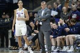 UConn's Kia Nurse, left, stands with head coach Geno Auriemma during a game last season.