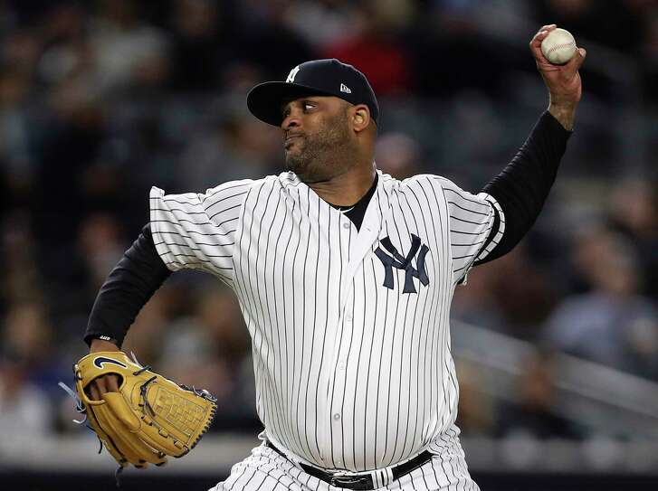 New York Yankees starting pitcher CC Sabathia pitches against the Houston Astros during the first inning of Game 3 of the ALCS at Yankee Stadium on Monday, Oct. 16, 2017, in New York.
