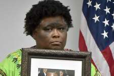 Demethra Telford of New Haven holds a photograph of her son Tyrick Keyes, 14, who was shot and killed in July, during a press conference Monday afternoon at  New Haven Police Department headquarters.