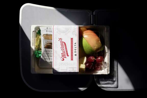 A fruit and cheese plate is one of the meal options on a Delta flight to Los Angeles from New York.  Continuing their emergence from hard times, some airlines have begun adding complimentary meals.