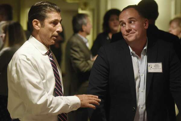 Staples baseball coach Frank Vartuli, left, and Stamford Senior Legion baseball coach Kevin Murray, 2017 sportspersons of the year, chat at the Fairfield County Sports Commission Sportsnight Hall of Fame Induction Ceremony at the Stamford Marriott Hotel & Spa in Stamford on Monday.