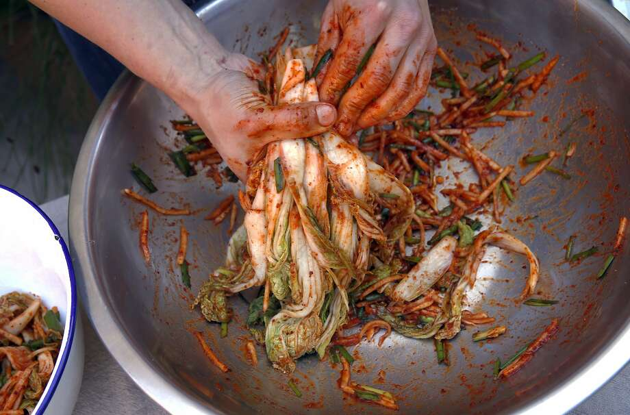 Chef Steve Joo mixes the ingredients used to create their kimchi. Photo: Michael Macor, The Chronicle