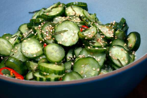 The chefs display the marinated cucumber salad, for a ssam. Chefs Julya Shin and Steve Joo the owners of a Korean ssam pop-up called Nokni, as seen on Mon. Sept.. 25, 2017, in Oakland, Ca.
