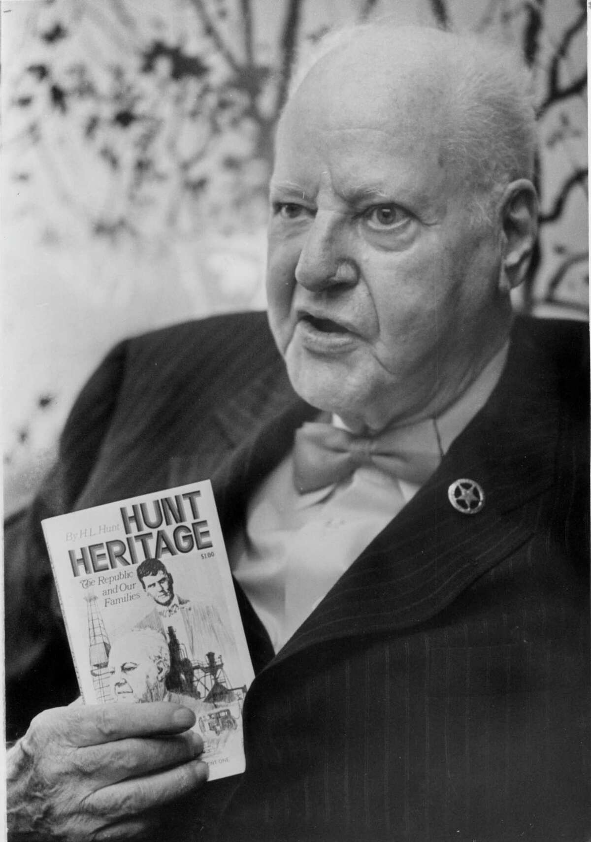 """PHOTO FILED: H.L. HUNT. 06/1973 - Dallas oil billionaire, H.L. Hunt, promotes his book, 'The Hunt Heritage', June 14, 1973. Blair Pittman / Houston Chronicle HOUCHRON CAPTION (06/14/1973): HUNT PLUGS BOOK. Dallas oil Billionaire H.L. Hunt here to visit friends and to promote his book, """"The Hunt Heritage,"""" says he is asking all non-Communists to write letters to the editors of newspapers urging preservation of freedom in the United States. He said the Watergate bugging was a disgrace. HOUCHRON CAPTION (11/29/1974); H.L. HUNT DIES AT AGE 85 HOUCHRON CAPTION (11/05/2000): None (H.L. Hunt Mug) HOUCHRON CAPTION (11/05/2000): H.L. Hunt in 1973 HOUSTON CHRONICLE SPECIAL SECTION/TEXAS MAGAZINE: 100 TALL TEXANS."""
