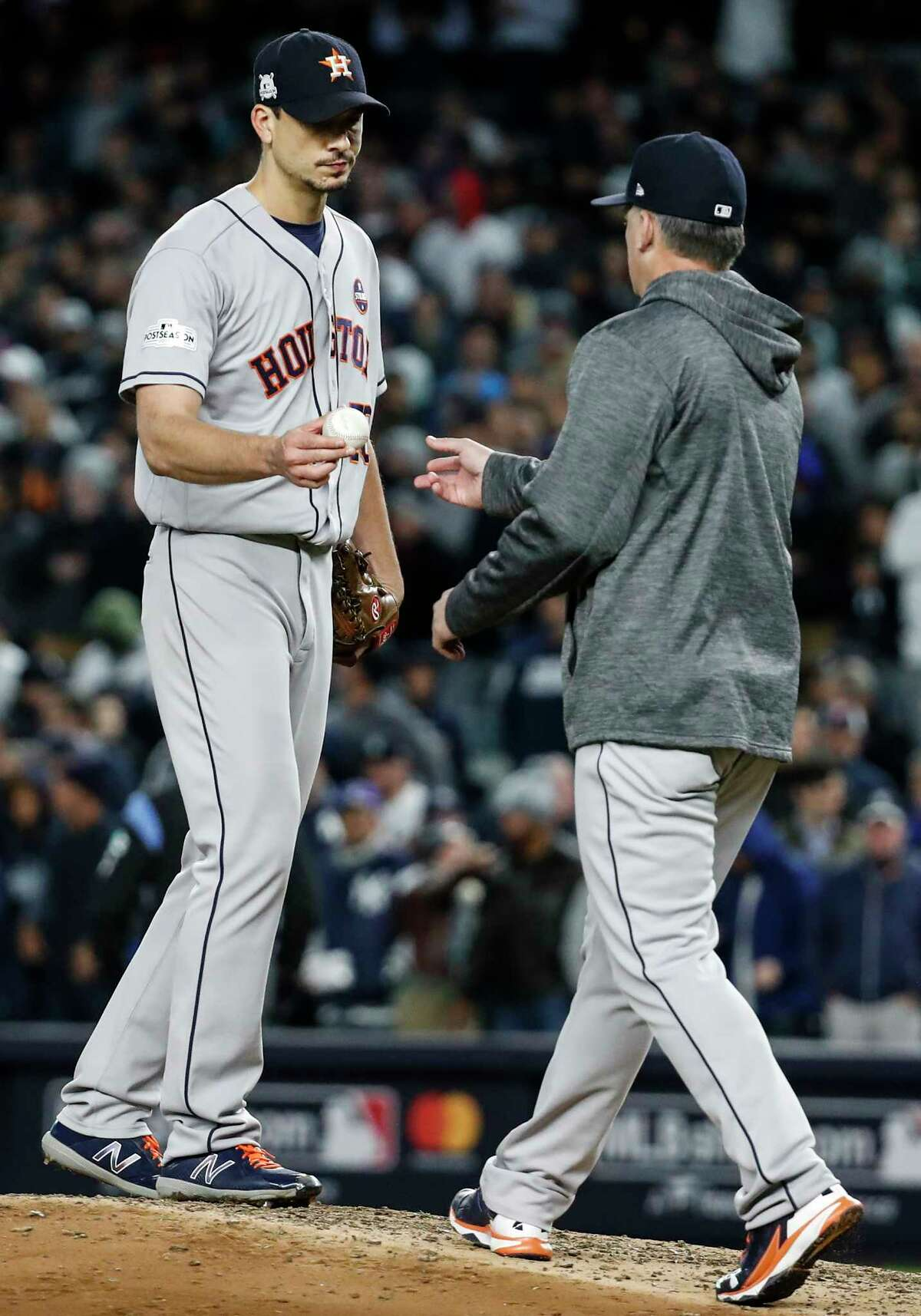 Houston Astros starting pitcher Charlie Morton (50) is taken from the game by manager A.J. Hinch during the fourth inning of Game 3 of the ALCS against the New York Yankees at Yankee Stadium on Monday, Oct. 16, 2017, in New York.