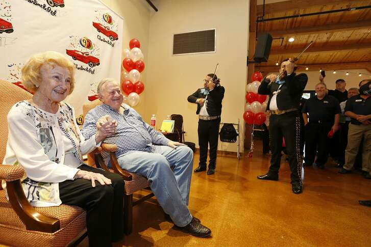 "Charline McCombs and Billy Joe ""Red"" McCombs enjoy the music of Mariachi Azul de San Antonio during his 90th birthday celebration Monday."