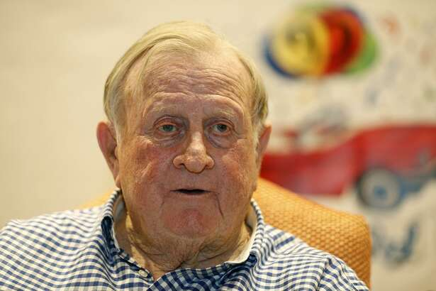 """Billy Joe """"Red"""" McCombs answers questions from the media during his 90th birthday celebration Monday."""
