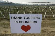 A sign thanking first responders hangs by a newly planted vineyard Monday, Oct. 16, 2017, in Napa, Calif. With the winds dying down, fire crews gained ground as they battled wildfires that have devastated California wine country and other parts of the state over the past week, and thousands of people got the all-clear to return home. (AP Photo/Eric Risberg)
