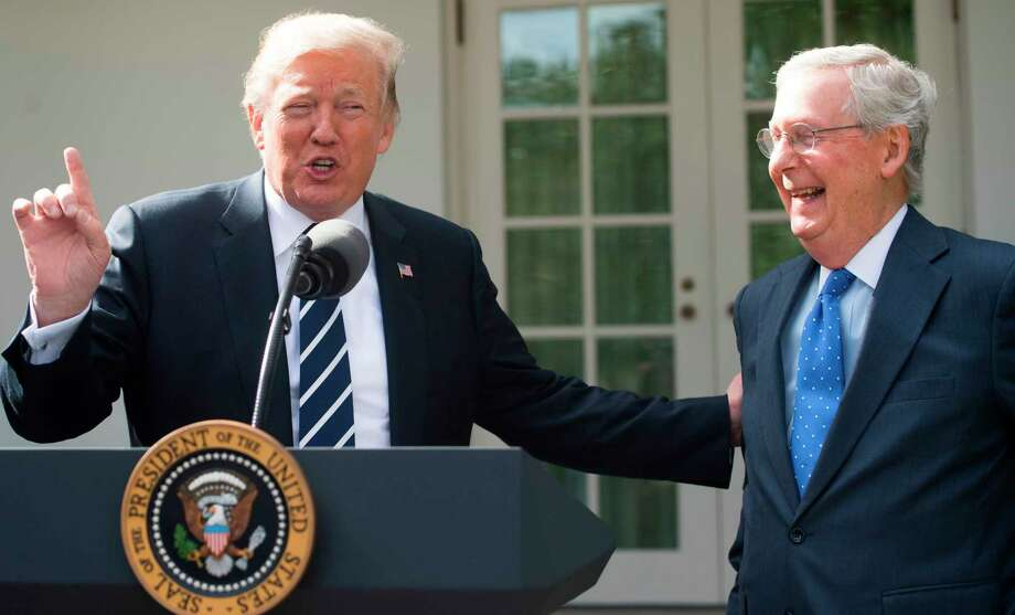 US President Donald Trump speaks to the press alongside Senate Majority Leader Mitch McConnell (R), Republican of Kentucky, in the Rose Garden of the White House in Washington, DC, October 16, 2017. / AFP PHOTO / SAUL LOEBSAUL LOEB/AFP/Getty Images Photo: SAUL LOEB / AFP or licensors