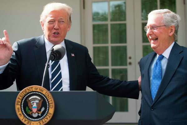US President Donald Trump speaks to the press alongside Senate Majority Leader Mitch McConnell (R), Republican of Kentucky, in the Rose Garden of the White House in Washington, DC, October 16, 2017. / AFP PHOTO / SAUL LOEBSAUL LOEB/AFP/Getty Images