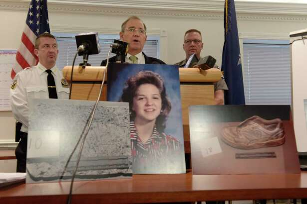Schenectady County District Attorney Bob Carney talks about the murder of Suzanne Nauman, seen in the foreground, during a press conference on Monday, Oct. 16, 2017, in Schenectady, N.Y.  Nauman was murdered in 1995.  (Paul Buckowski / Times Union)