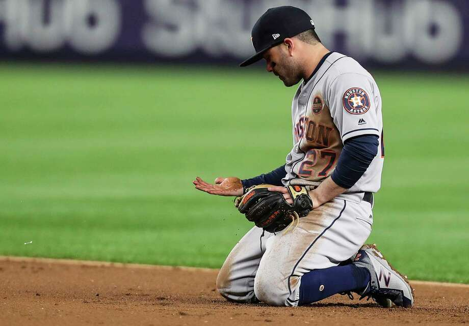 PHOTOS: A look at the Astros loss to the Yankees in Game 3Houston Astros second baseman Jose Altuve looks down at his hand after making a diving stop and throwing out New York Yankees shortstop Didi Gregorius at first during the third inning of Game 3 of the ALCS at Yankee Stadium on Monday, Oct. 16, 2017, in New York. Photo: Michael Ciaglo, Houston Chronicle / © 2017 Houston Chronicle