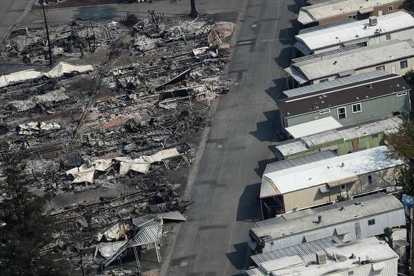 SANTA ROSA, CA - OCTOBER 11:  An aerial view of mobile homes that were destroyed by the Tubbs Fire at the Journey's End Mobile Home Park on October 11, 2017 in Santa Rosa, California. At least 21 people have died in wildfires that have burned tens of thousands of acres and destroyed over 3,000 homes and businesses in several Northen California counties.  (Photo by Justin Sullivan/Getty Images)