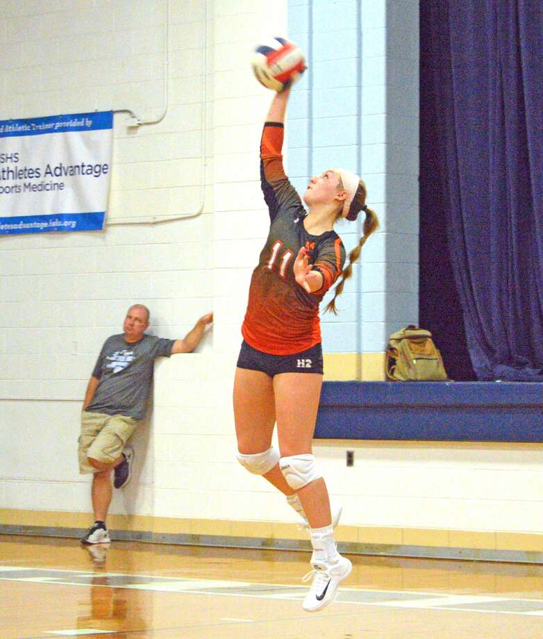 Edwardsville senior Rachel Verdun makes a serve during the second game of Monday's match at Breese Mater Dei.