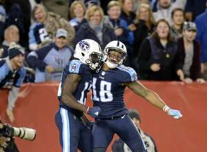 Tennessee Titans wide receiver Taywan Taylor (13) celebrates with Rishard Matthews (18) after Taylor scored a touchdown on a 53-yard pass against the Indianapolis Colts in the second half of an NFL football game Monday, Oct. 16, 2017, in Nashville, Tenn. (AP Photo/Mark Zaleski)