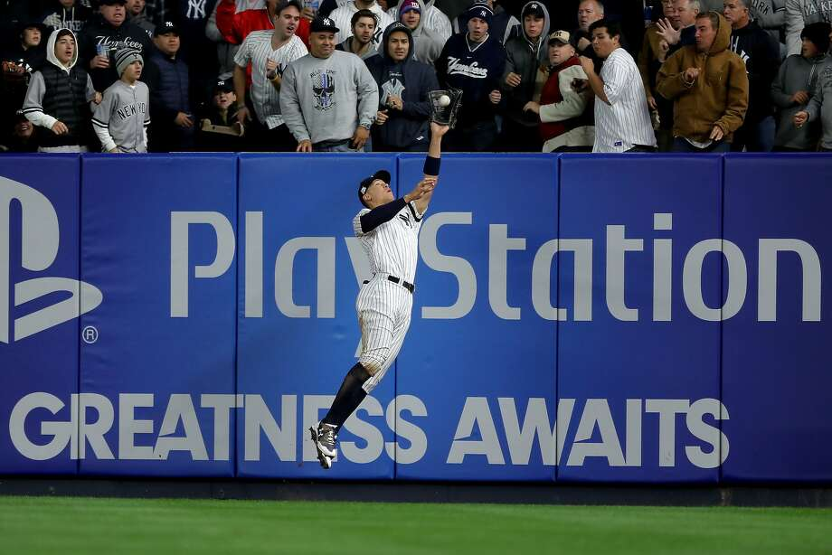 New York right fielder Aaron Judge hits the wall while catching a long fly off the bat of the Houston Astros' Yuli Gurriel during the fourth inning in Game 3 at Yankee Stadium. Photo: Elsa
