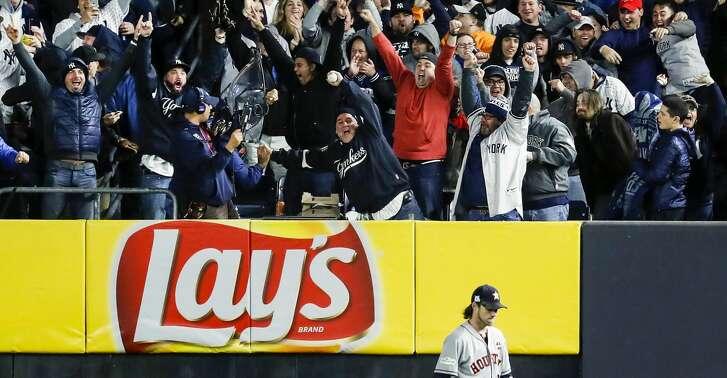 New York Yankees fans celebrate over Houston Astros right fielder Josh Reddick after Yankees third baseman Todd Frazier hit a 3-run home run off of Astros starter Charlie Morton inning of Game 3 of the ALCS at Yankee Stadium on Monday, Oct. 16, 2017, in New York. ( Karen Warren  / Houston Chronicle )