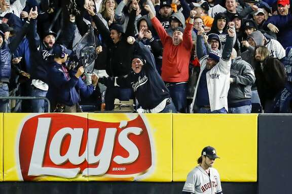 New York Yankees fans celebrate over Houston Astros right fielder Josh Reddick after Yankees third baseman Todd Frazier hit a 3-run home run off of Astros starter Charlie Morton inning of Game 3 of the ALCS at Yankee Stadium on Monday, Oct. 16, 2017, in New York. ( Karen Warren  / Houston Chronicle )