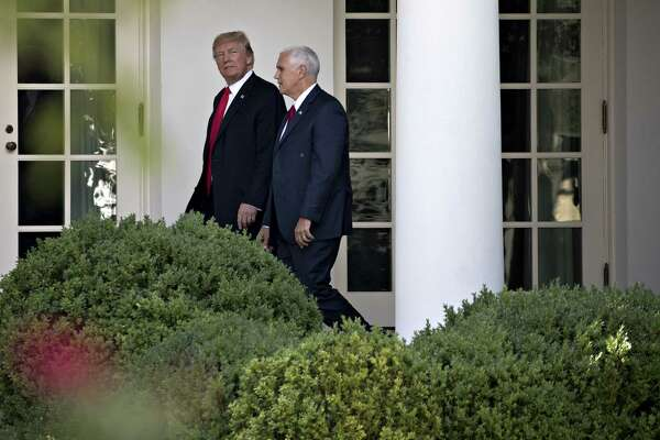 President Donald Trump (left) and Vice President Mike Pence walk to the Oval Office of the White House in Washington on July 24, 2017.
