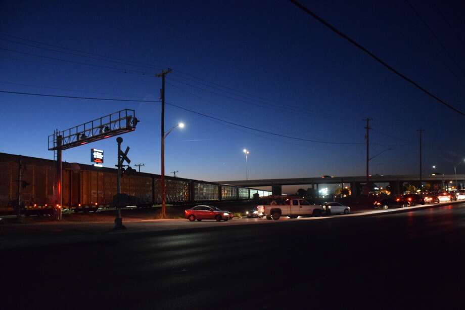 Police on Tuesday morning searched for a driver who tried to cruise past a South Side train crossing, but got hit by a train and then fled. Photo: Caleb Downs / San Antonio Express-News