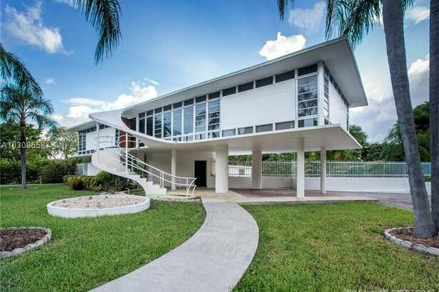 """The iconic """"Jetsons House"""" designed in 1949 by noted architect Rufus Nims, one of the leading practitioners of tropical modernism, is situated on a 16,214 s/f lot in gated Morningside, a bohemian residential enclave of tree-lined streets nestled between Biscayne Bay and the Miami Design District."""