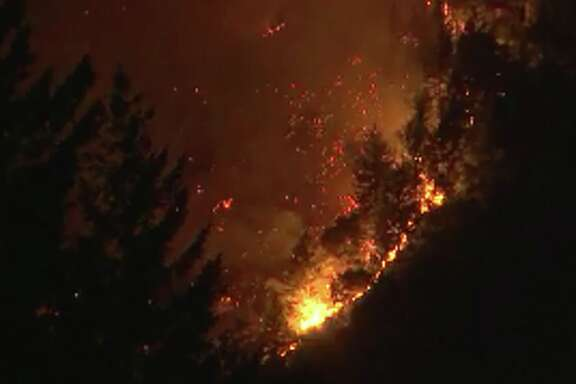 A fire burning in Boulder Creek in the Santa Cruz mountains prompted evacuations early on Tuesday, October 17, 2017.